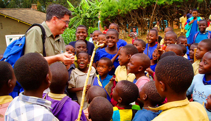 EWB-USA founder Dr. Bernard Amadei visits with children in an EWB-USA partner community in East Africa.